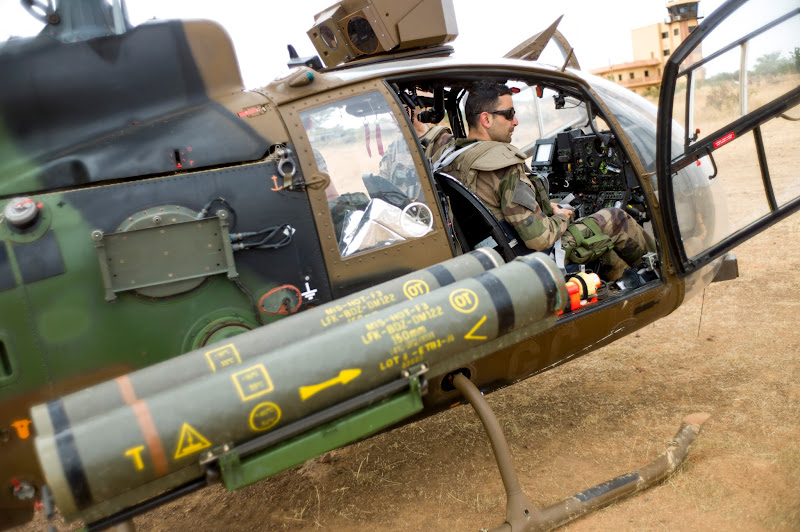Photo: A French Gazelle military helicopter, flying back from the city of Timbuktu, arrives at the French army base camp airport on January 28, 2013 in Sevare. French forces are advancing towards Mali's Islamist-held north after taking up positions in the towns of Niono and Sevare, a spokesman for the French military operation codenamed Serval said January 28, 2013. Sevare has a strategically important airport which could help serve as a base for operations further north. It is about 630 kilometres north-east of Bamako.  AFP PHOTO / FRED DUFOUR        (Photo credit should read FRED DUFOUR/AFP/Getty Images)