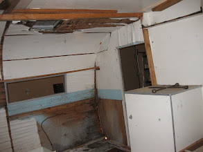 Photo: Well, it used to be a front kitchen, but there is nothing left of it other than the gas line for where the stove top was.