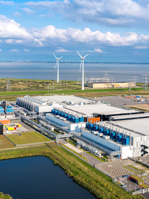A European Google data center with wind turbines in the background