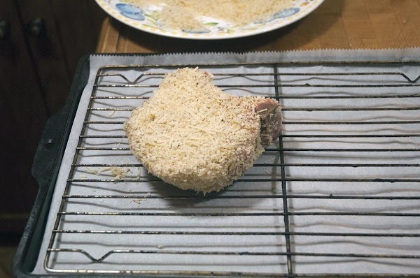 Turn breaded side up, and place on a baking sheet fitted with a piece...