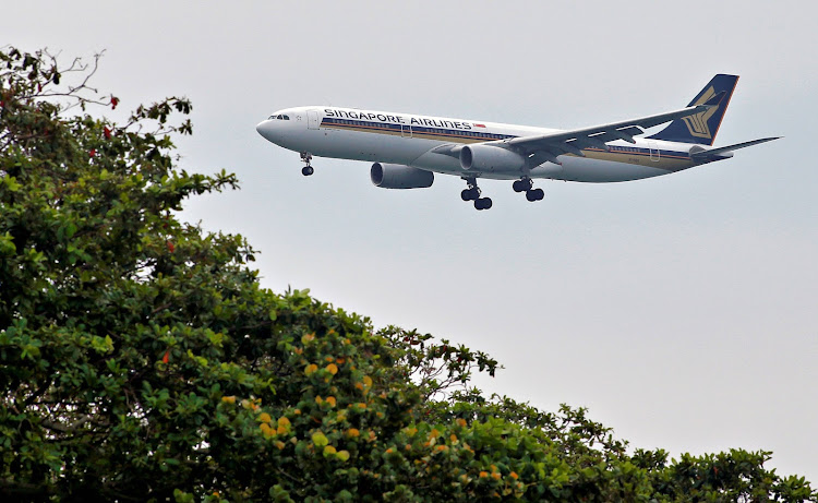 FILE PHOTO: A Singapore Airlines Airbus A330-300 airplane approaches to land at Changi International Airport in Singapore June 10, 2018.
