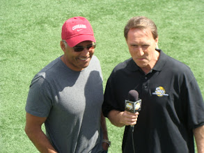 Photo: Former WSU Cougar and New Orleans Saints running back Reuben Mayes talking to the radio sideline reporter during the game.