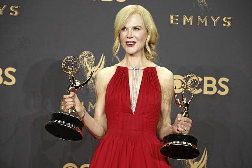 Nicole Kidman poses with the Emmys for outstanding limited series and outstanding lead actress in limited series for Big Little Lies. Picture: REUTERS