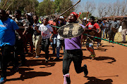Protesters from hostels in Johannesburg marched on September 8 2019. Carrying weapons, including knobkerries, the men sang, 'foreigners must go back to where they came from'.