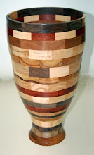"Photo: Denis Zegar - segmented vase (red heart, yellow heart, purple heart, walnut, oak, cherry, curly maple) - 15""x8"" [08.06]"