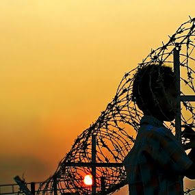 In the barbed wire by Harry Suryo - Babies & Children Children Candids