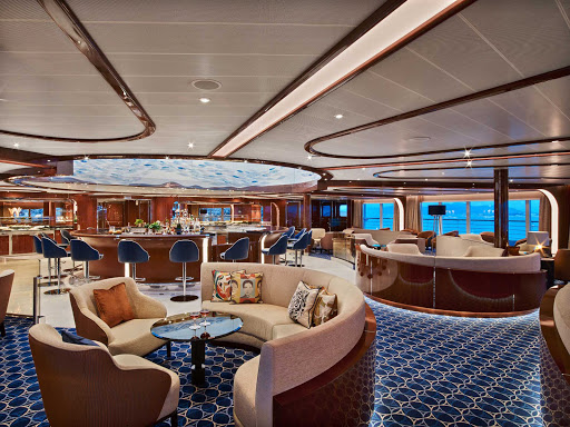 Enjoy a drink and meet interesting new people in the Observation Bar of Seabourn Encore.