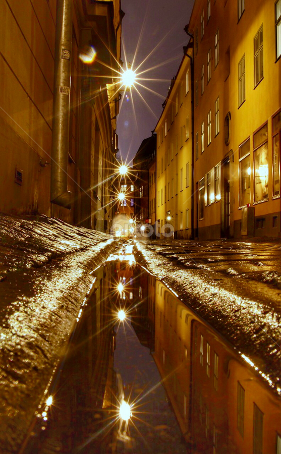 Rainy night in old town Stockholm  by Eva Larsson - City,  Street & Park  Night ( water reflects street city sweden )
