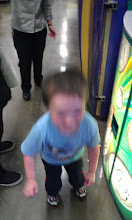 "Photo: This is the Happy Dance when a few pennies came out of the discarded hopper. At this point, The Boy thought this was his ""prize"" for putting in all those coins...poor baby didn't have a clue!!"