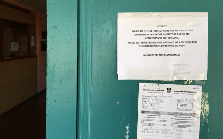 Notices on the door of the shut down Home Affairs office in Atlantis on Friday.