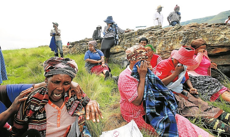 Parents and grandparents break down after being told searchers had found the bodies of four children swept away by a flash flood while crossing a river between Freystata village and Popopo Primary on March 7 2019..