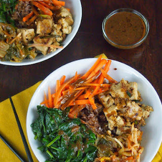 Buddha Bowl with Spinach, Marinated Tofu, Kimchi and Soy-Miso Dressing.