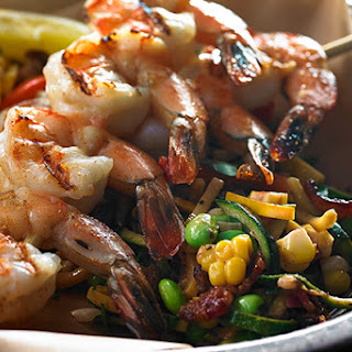 Creamy Zucchini Succotash with Grilled Shrimp Skewers.