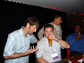 Photo: Adam Moons talks about the price of fish while Steve Lynch sips his beer