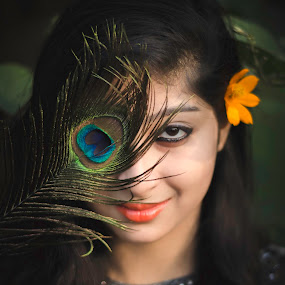 Natural Beauty  by Anuruddha Das - People Portraits of Women ( nature, female, feather, light, peacock, eye, eyes,  )