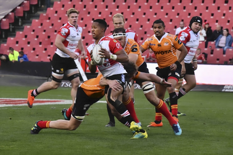 Sylvian Mahuza of the Xerox Golden Lions gets away from a tackle during the Currie Cup match against the Toyota Free State Cheetahs at Emirates Airline Park on September 08, 2018 in Johannesburg.