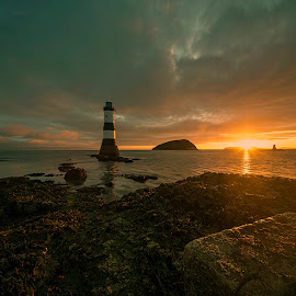 Penmon Rise by Peter Rollings - Landscapes Sunsets & Sunrises ( sunrise, lighthouse, rocks, puffin island, sea,  )
