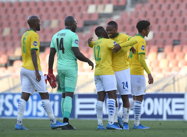 Mamelodi Sundowns attacker Sibusiso Vilakazi celebrates with teammates after scoring his first league goal of the season.