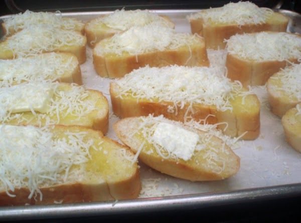 Slice bread loaf into medium sized slices and lay out on a cooking sheet....