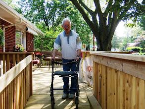 Photo: Bill using ramp and walker