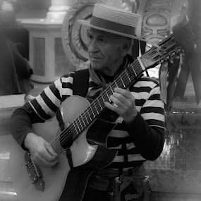 Man play Guitar by Jason Murray - People Portraits of Men ( old, black and white, striped, guitar, stripes, italy, portrait, man, shirt,  )