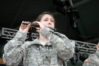 Photo: Staff Sgt. Jennifer Duncan plays the piccolo during the 34th Red Bull Infantry Division Band's performance at the Minnesota State Fair's Military Appreciation Day Aug. 30, 2011 in St. Paul, Minn.