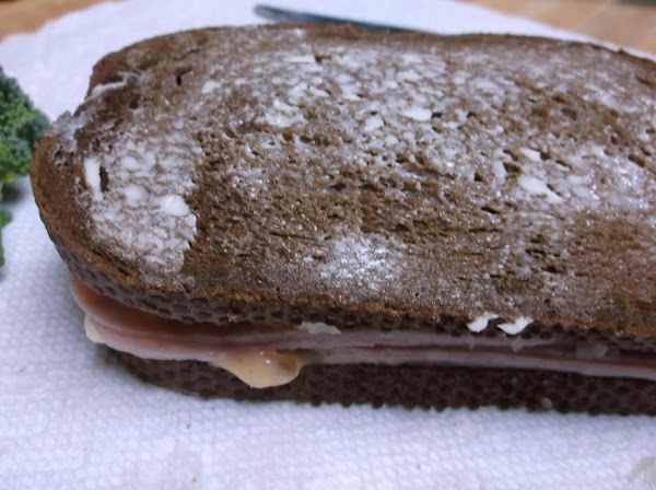 Place buttered slice of bread on top, buttered side up.