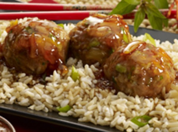 Top cooked meatballs with sauce, Serve over hot cooked rice with additional green onions...