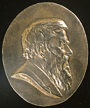 Photo: The bronze Wallace Medal of the A. R. Wallace Memorial Fund, which is awarded for outstanding contributions to Wallace scholarship or the public understanding of his life and work. Photograph by George Beccaloni, but image is in public domain.