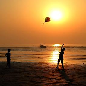 kite flying by Vijayendra Desai - Landscapes Sunsets & Sunrises