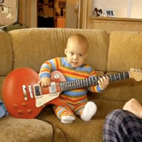 baby playing guitar