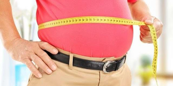 male measuring waist with measuring tape