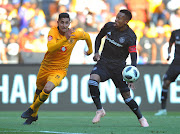 Leonardo Castro challenges Happy Jele during the Absa Premiership match between Orlando Pirates and Kaizer Chiefs at FNB Stadium on October 27, 2018.