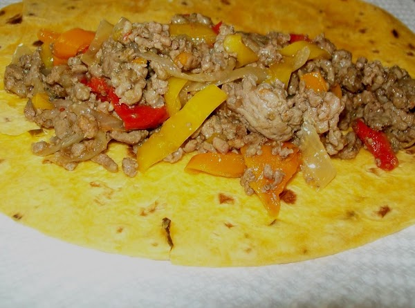 Place about 2 or 3 heaping spoonfuls of the meat onto the tortillas' and...