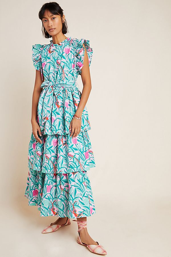 Model wears tiered floral Anthropologie Leilani Maxi dress