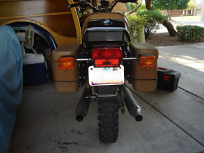 Photo: Rear view of the nearly bald rear tire, and how it chewed up the rear fender. Also new custom plate
