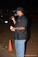 Photo: Track announcer Scott Borge . . .