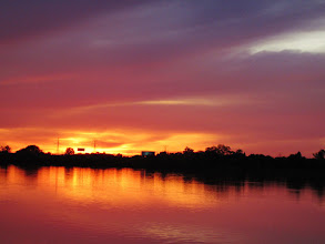 Photo: Bright sunset reflected in a lake at Eastwood Park in Dayton, Ohio.