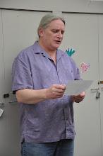 Photo: John's turn reading a poem. Hurray!