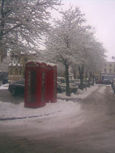 Photo: The tree line covered in snow, the phoneboxes still regularly used, with the continuing gangster extortion racket of mobile phone prices.