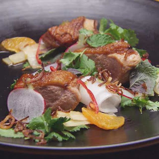 Caramel Duck with Mandarin, Pickled Daikon and Herbs.