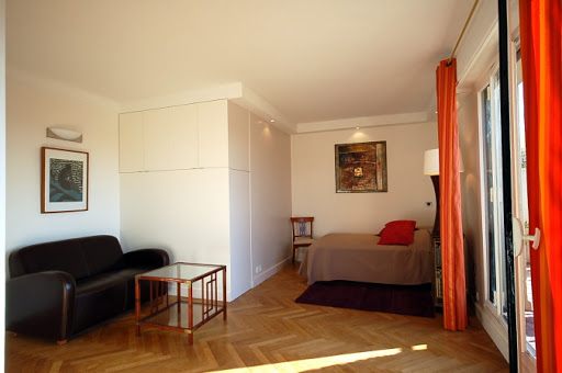 Bright living area at Studio apartment near Eiffel Tower