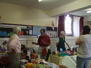 Photo: Inside the hall -busy stalls and cups of tea