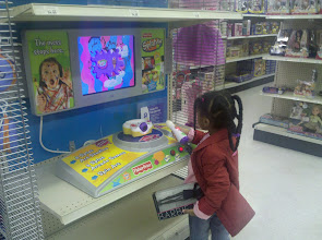 Photo: Kaleya plays with Splaster @ ToysRUs