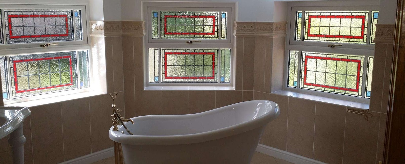 Bathroom with decorative windows
