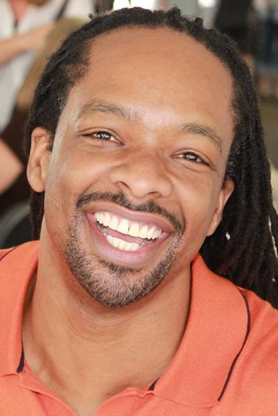 A close up of a person smiling for the camera  Description automatically generated