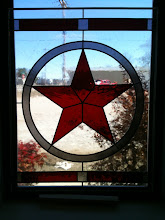 Photo: Texas star, red, white and blue. Stained glass window