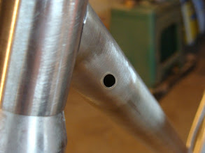 Photo: Sneaky internal brake routing in the down tube.