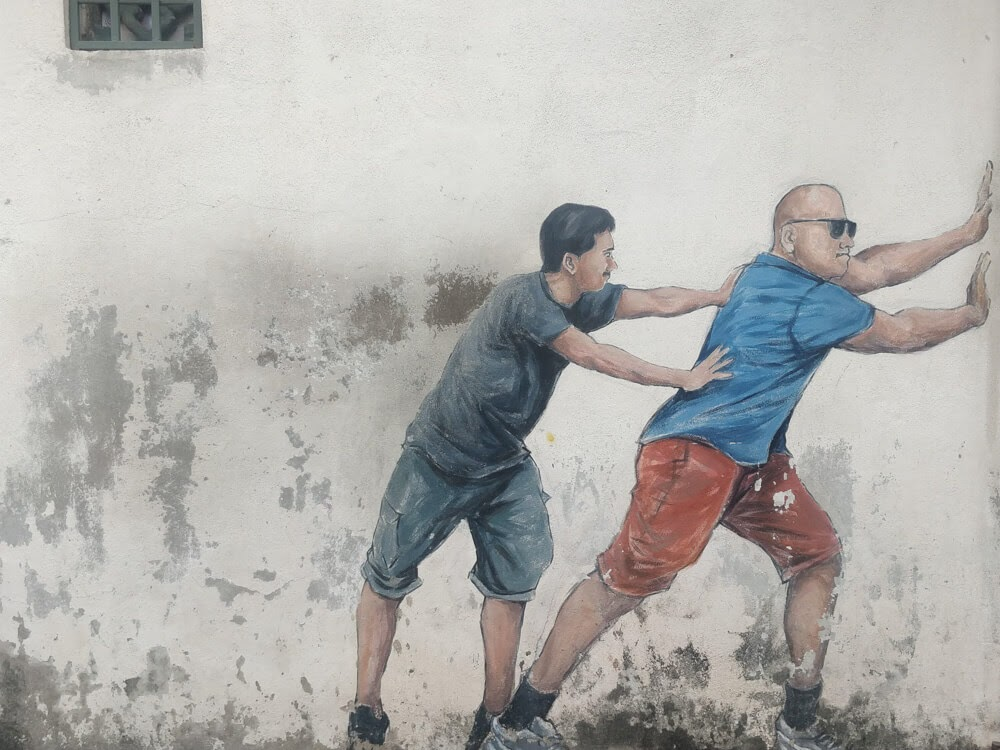 two+men+pushing+wall+murals+penang+streetart+penang+malaysia.