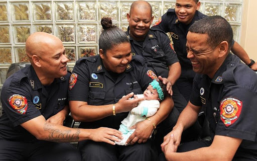 Firefighter heroes reunited with baby they saved from the brink of death